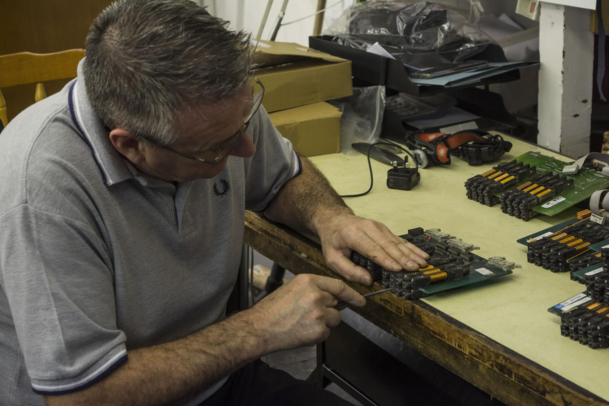 Our Engineer Repairing Solenoid Boards